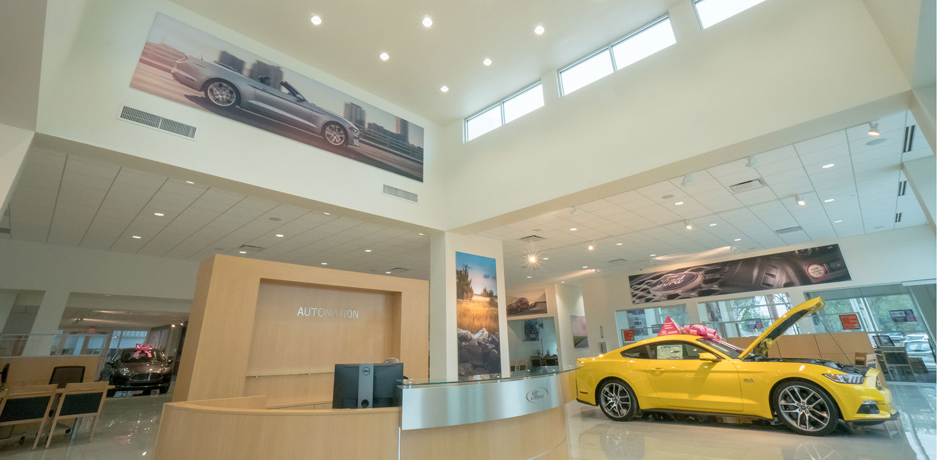 Showroom atrium with receptionist desk, and high windows