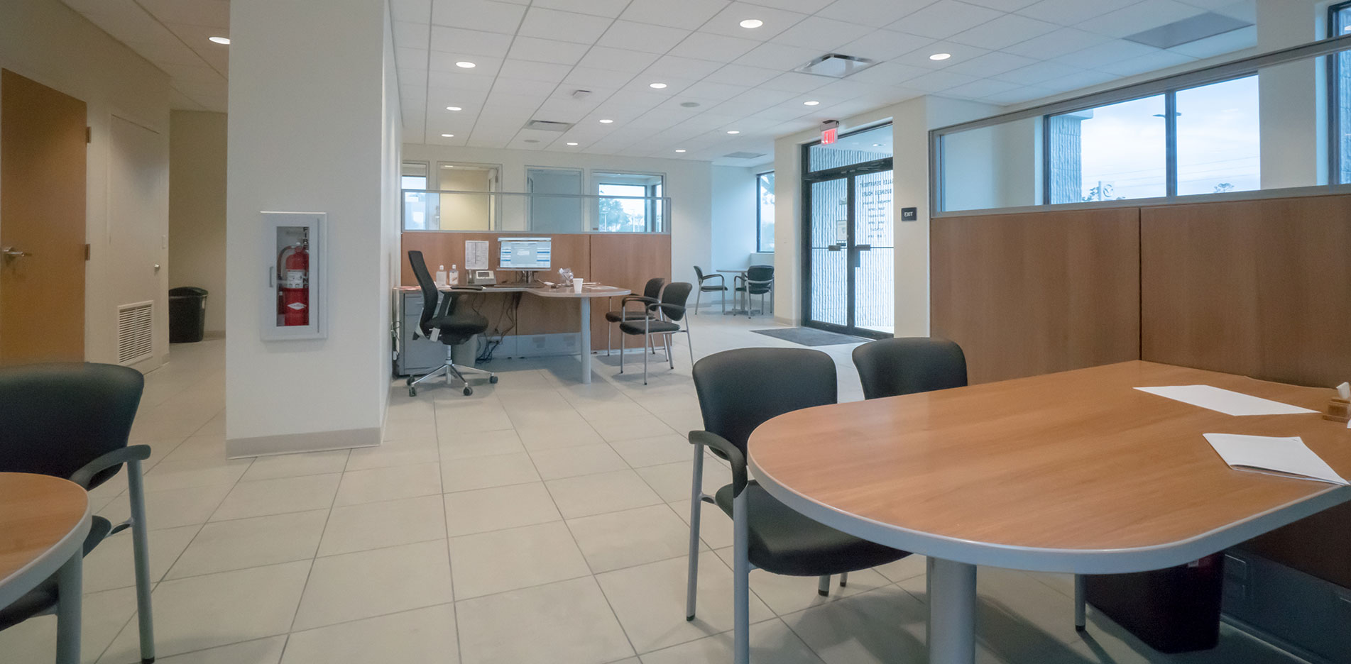 Sales center furnished with tables and chairs /></li> <li class=