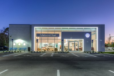 Dealership facade with inset lighting and large windows