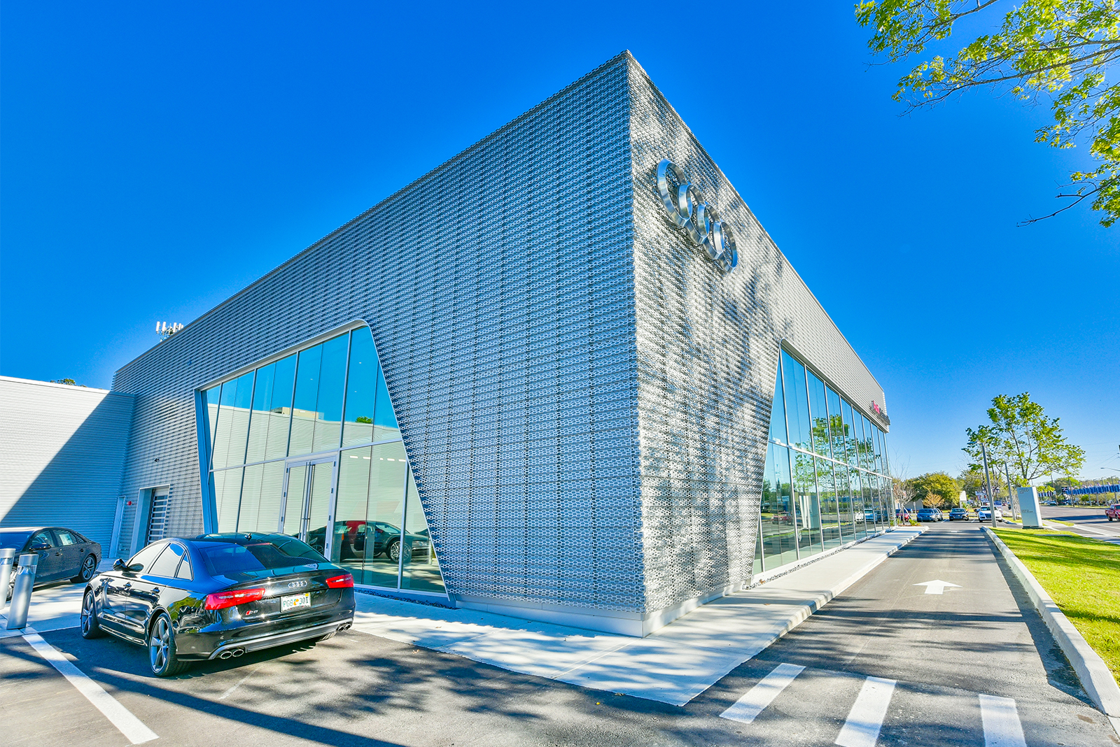 Front of the dealership with textured metal mesh facade