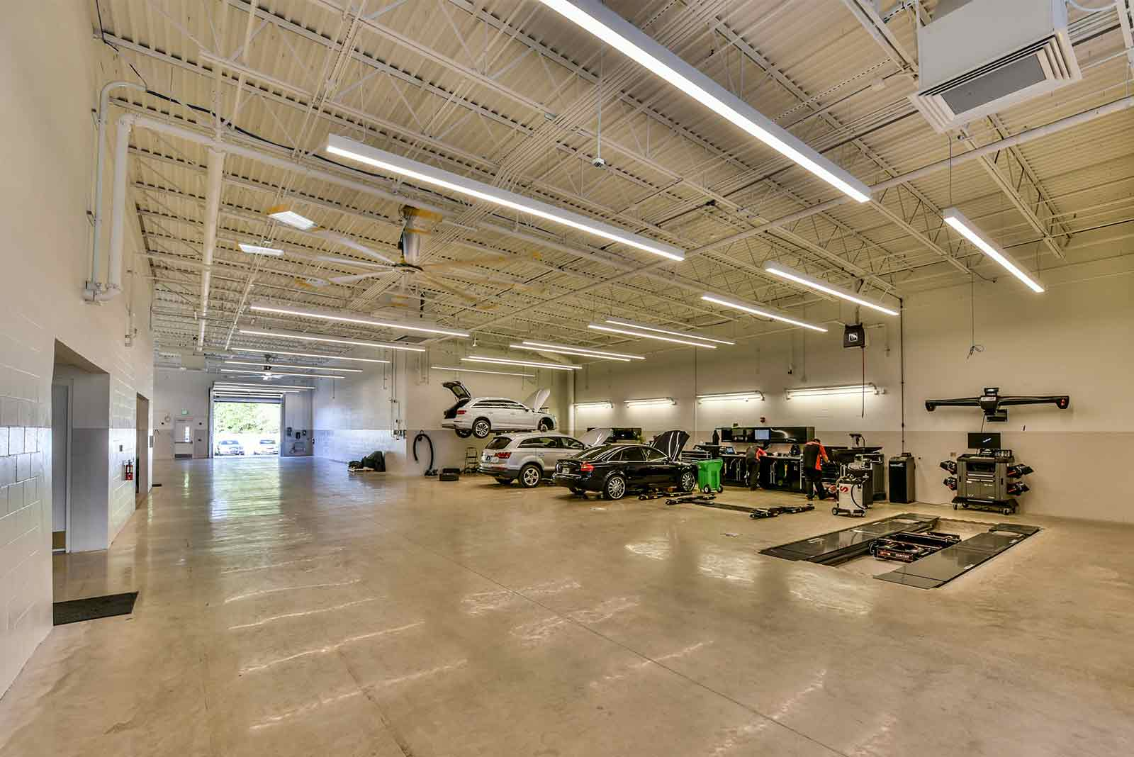 Car service bay furnished with maintenance equipment