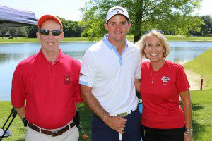 RLH's Kathy Casey with Arnold Palmer's grandson, Sam Saunders (middle), and a RMH volunteer.